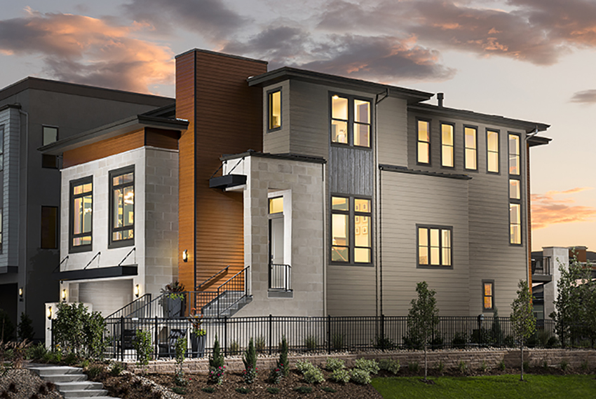 Single-family three-story modern home designed by Godden Sudik Architects in Colorado with metal accent roofs and modern wood paneling.