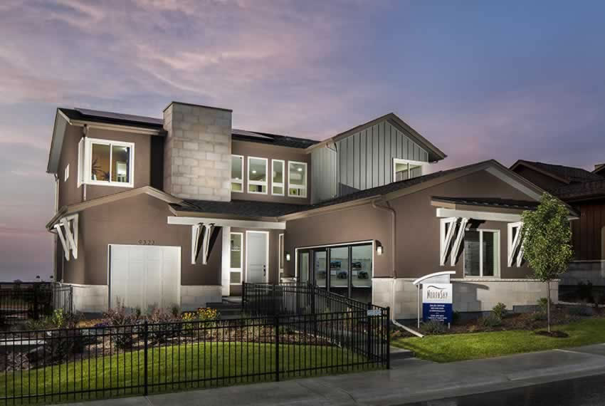 Contemporary two-story home, designed by Godden Sudik Architects, with modern accents, materials and paint selection.