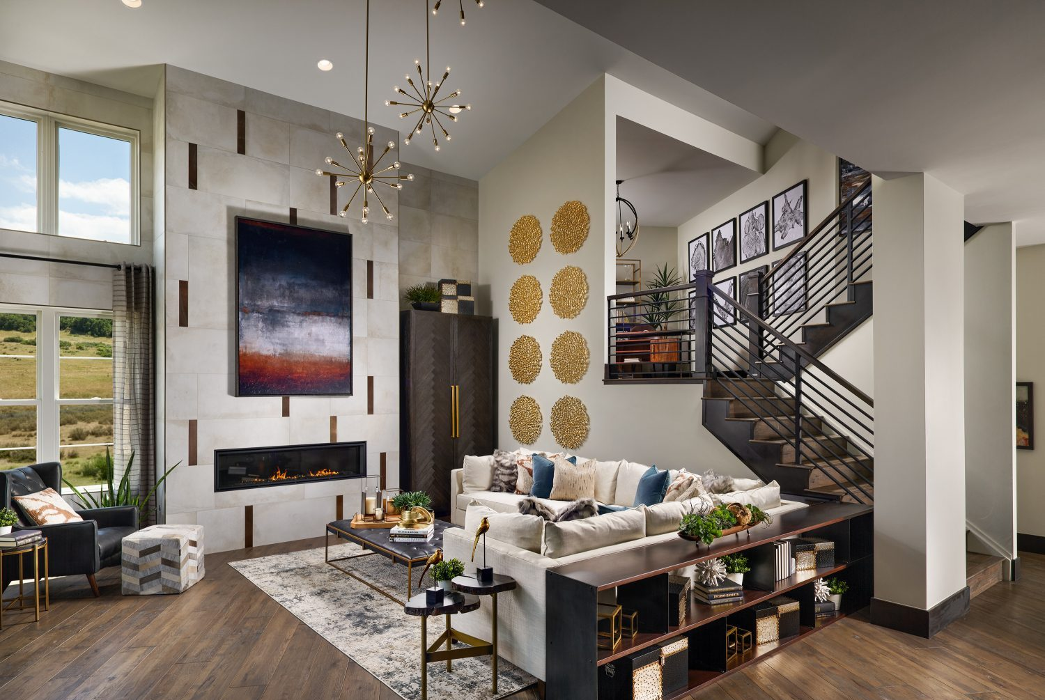 Award- winning double-height great room with open rail stair case, floor to ceiling windows and modern linear fireplace designed by Godden Sudik Architects