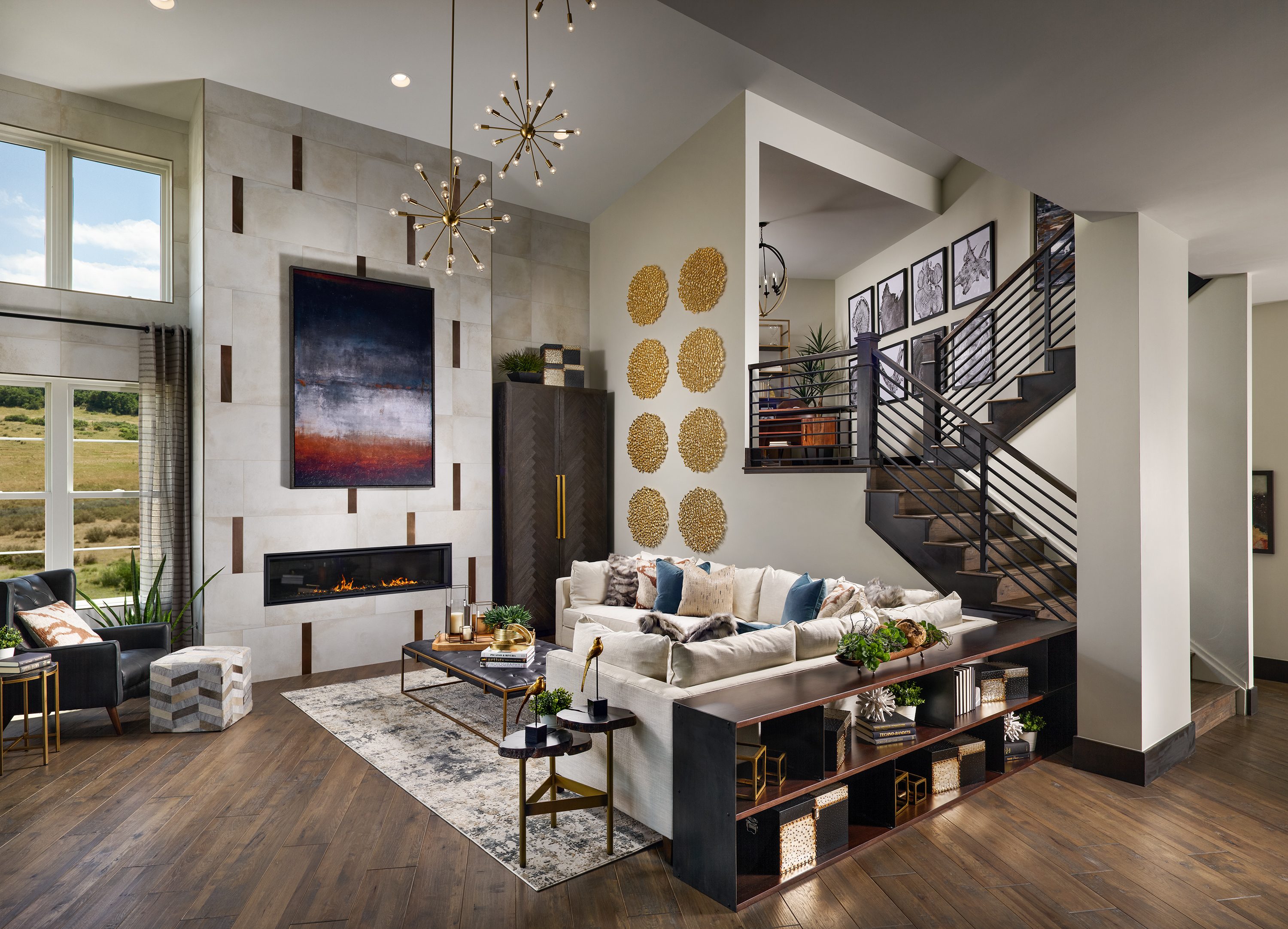 Stunning, award-winning living room design by Godden Sudik Architects with soaring double-height ceiling, lofted study space, and modern linear fireplace