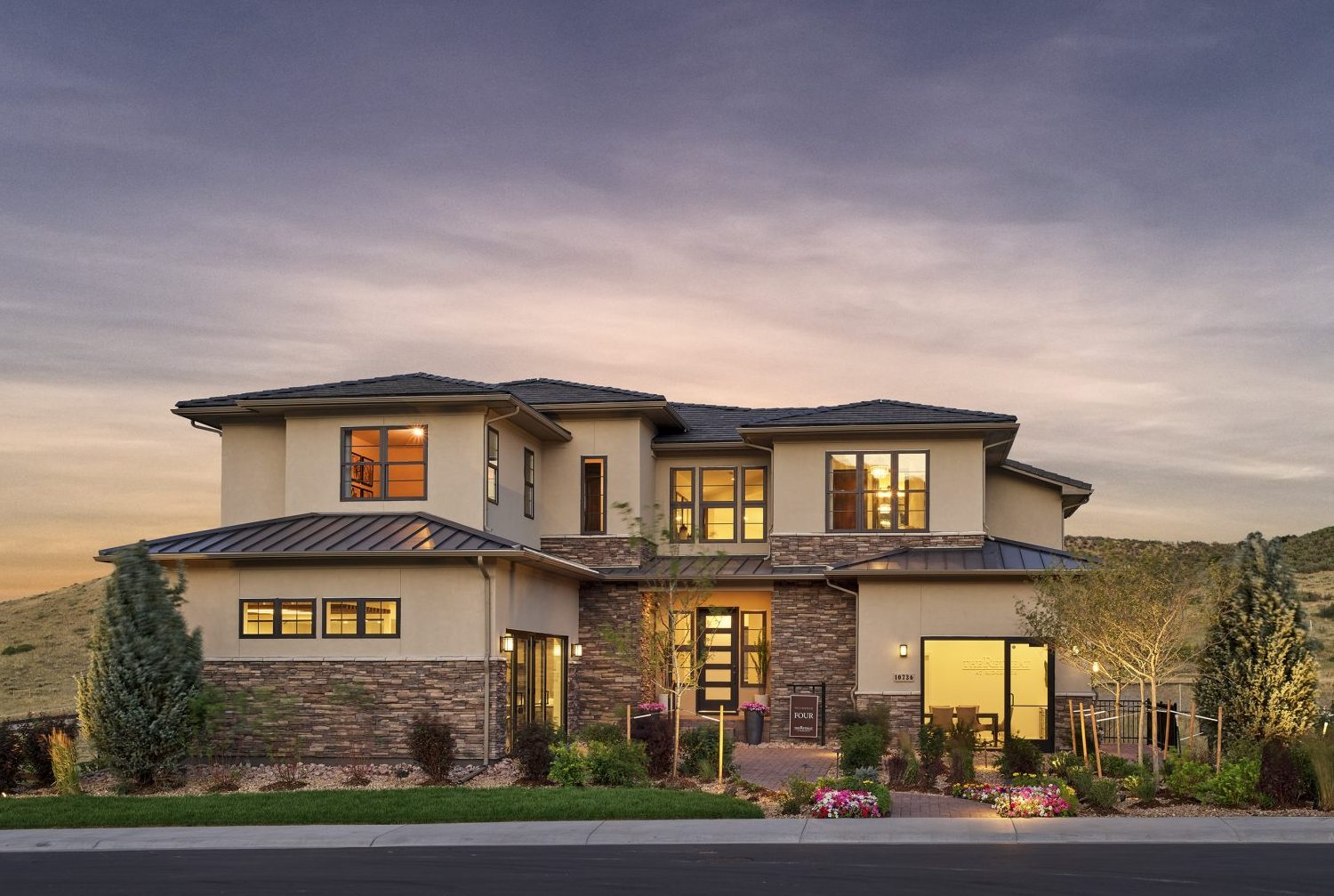 Award winning, single-family home design by Godden Sudik Architects in the Colorado foothills, featuring a modern prairie style with natural stone and stucco.