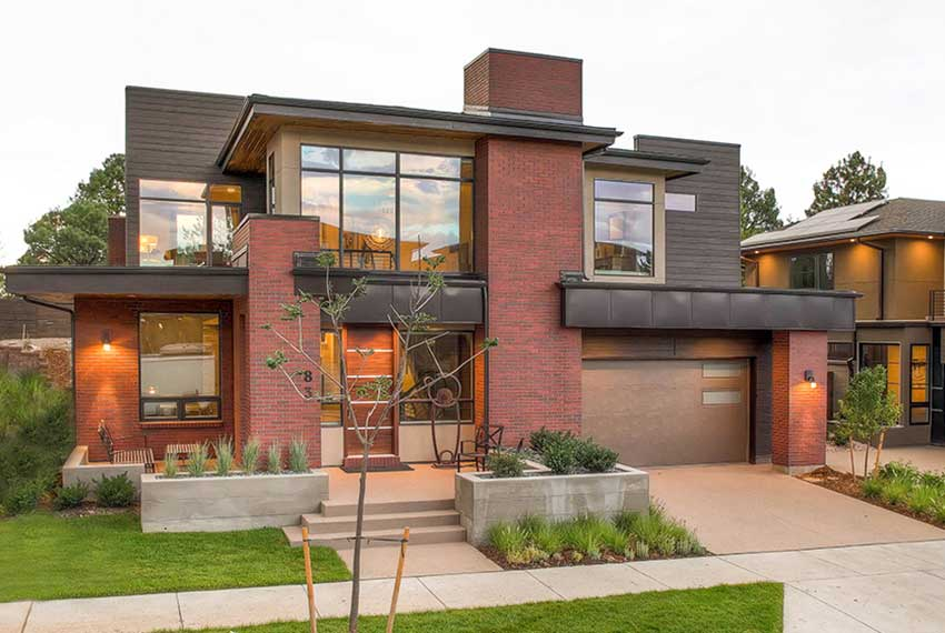 Modern Denver custom home with red brick and metal accents
