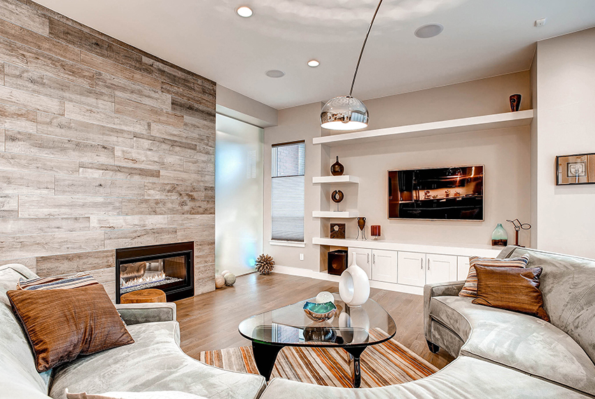 Spacious Living Room in Custom Home with Fireplace and TV Wall
