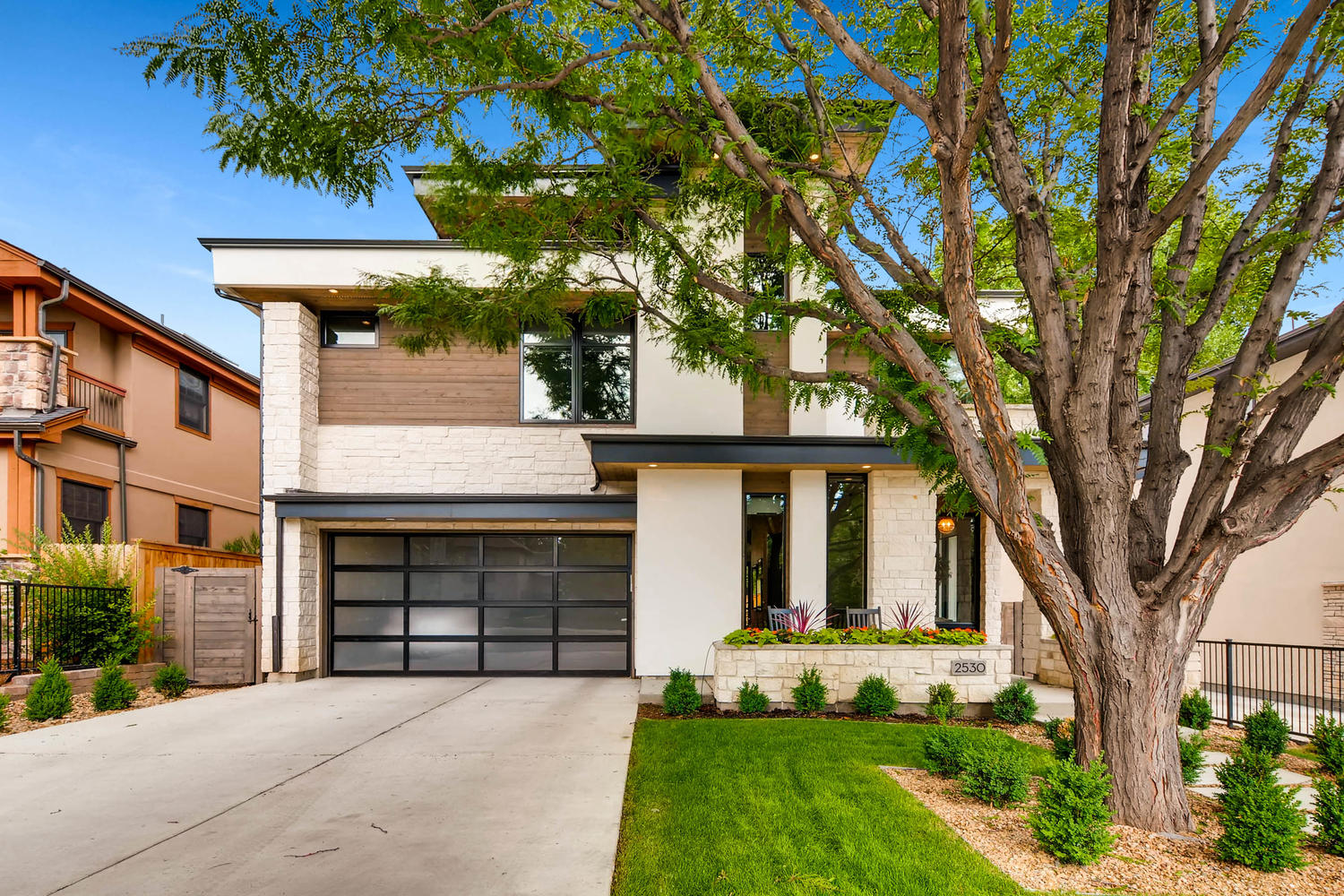 Modern Denver Custom Home with Flat Metal Roof and Wood Accents
