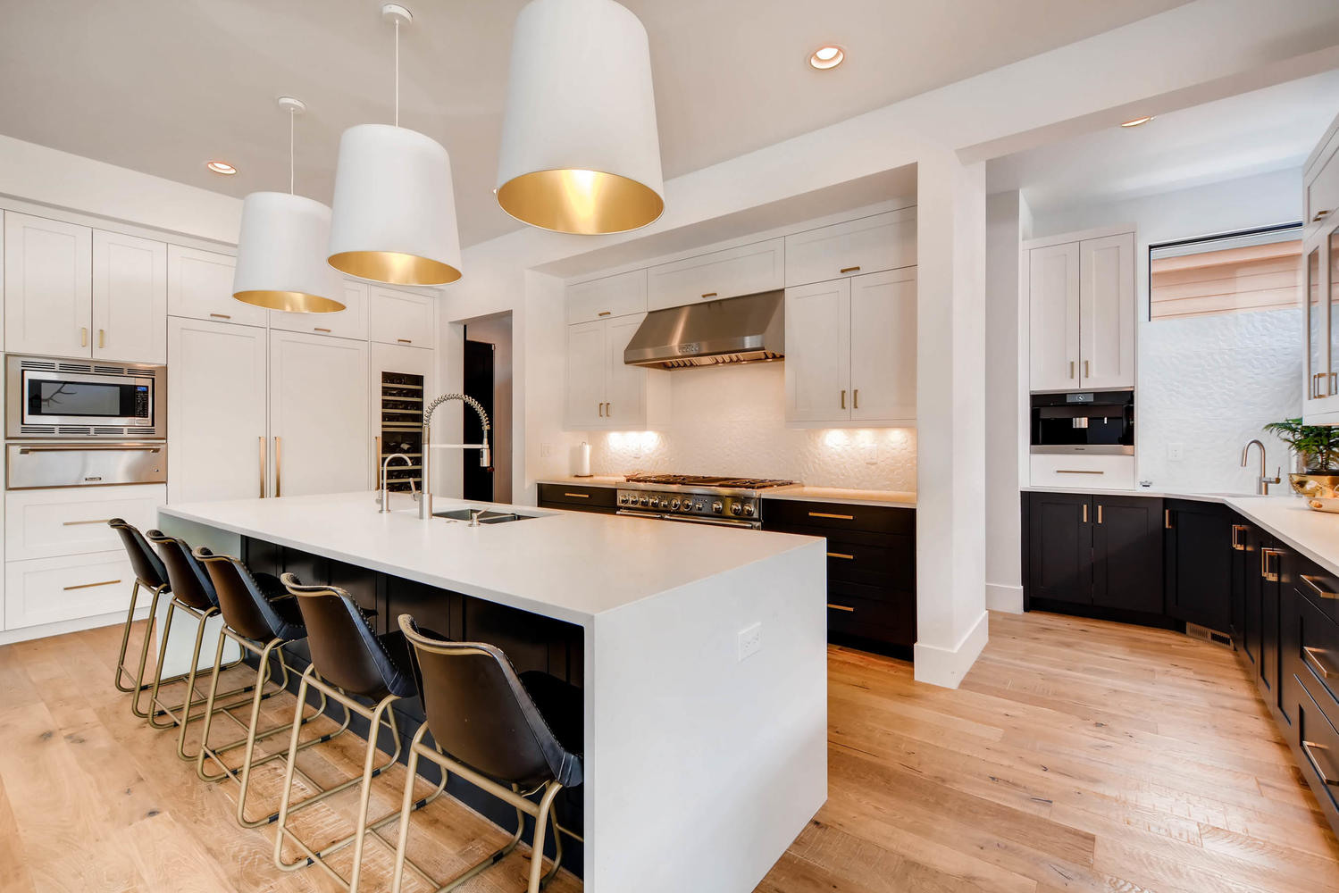 Modern White Farmhouse Kitchen Interior with Kitchen Island and Black Accent Cabinets