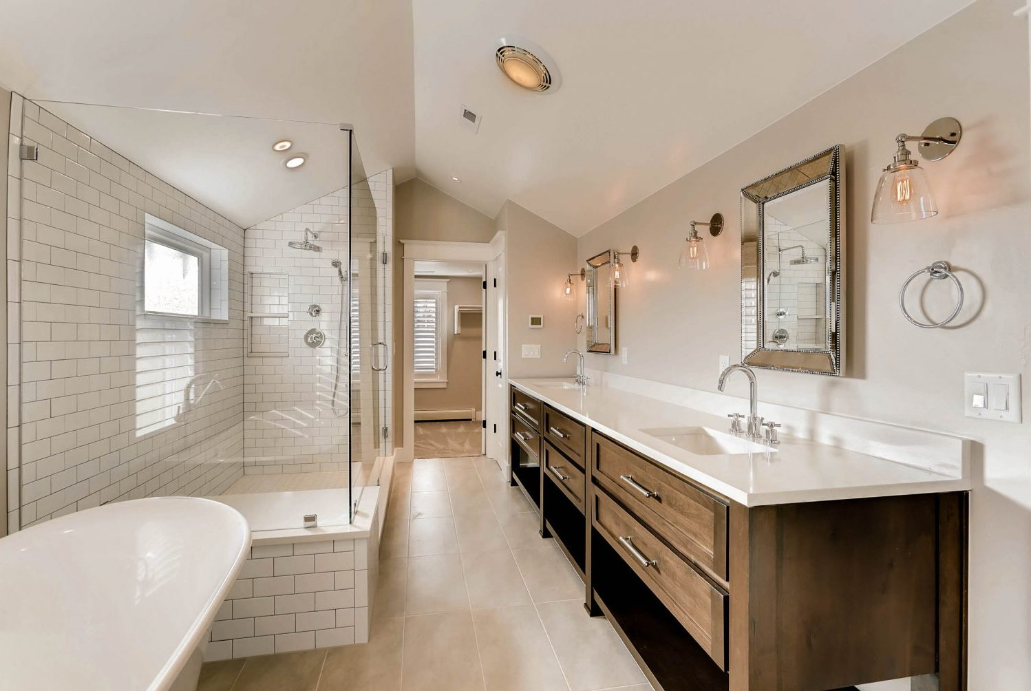 Remodeled master bathroom in historic Denver home designed by Godden Sudik architects with claw-foot tub and steam shower