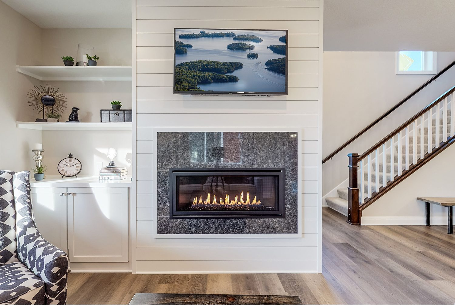 Modern living room with fireplace and accent shiplap siding designed by Godden Sudik Architects