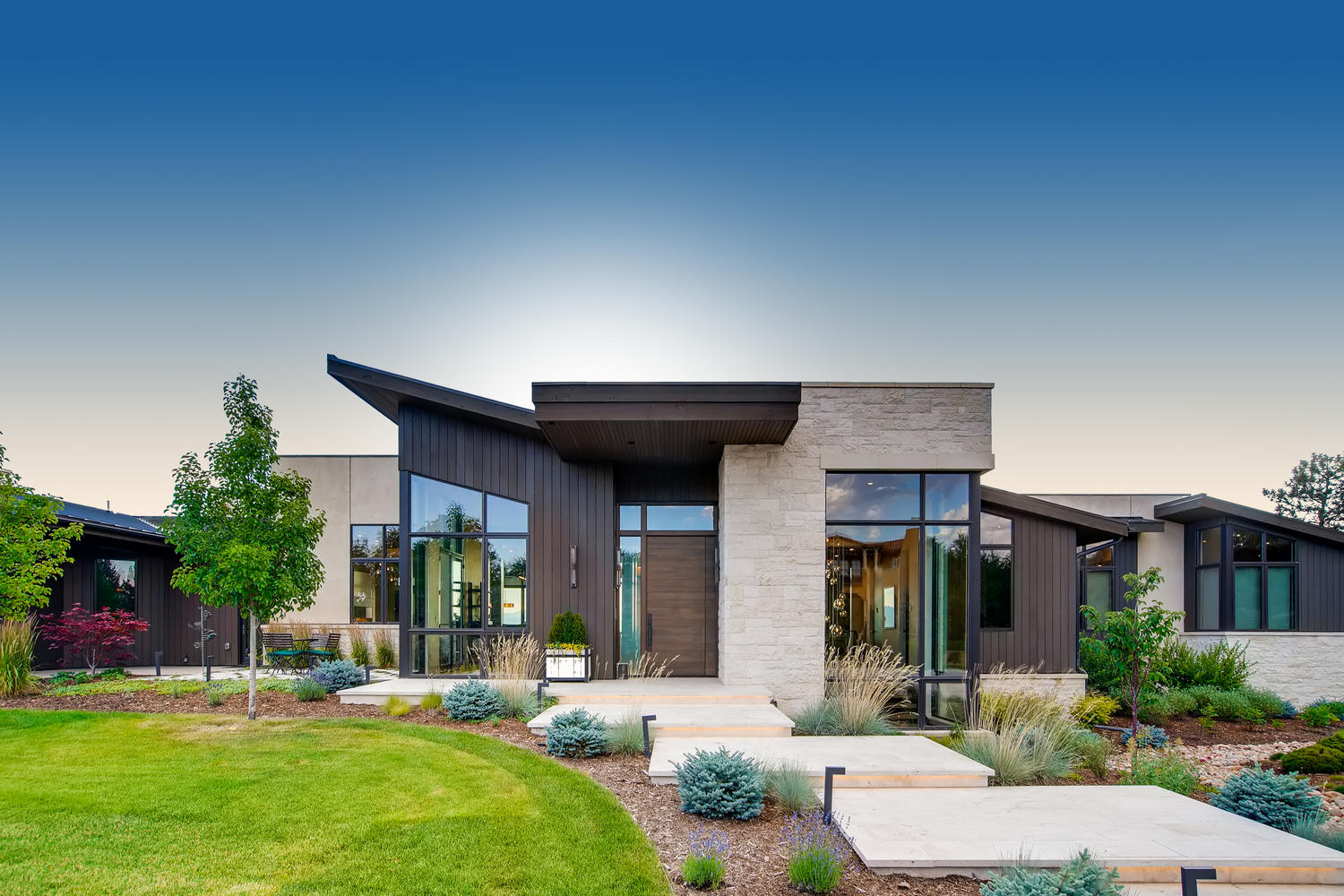 Modern Denver home designed by Godden Sudik Architects with stone accents and modern wood paneling exterior details.