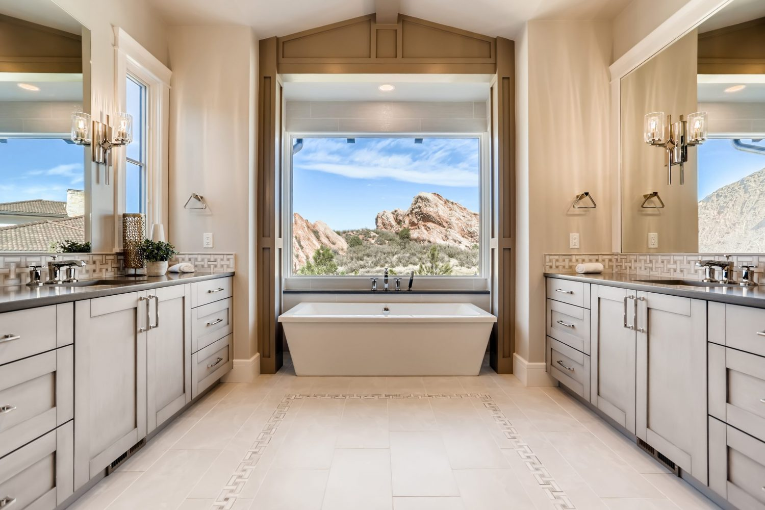 Master Bathroom with stand alone tub looking out onto the Colorado landscape that features double vanities and marble finishes