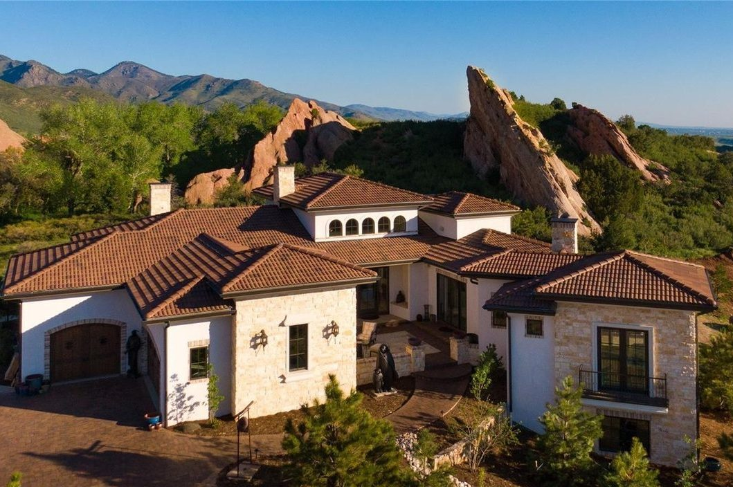 Custom Tuscan style home in the foothills of Colorado designed by Godden Sudik Architects