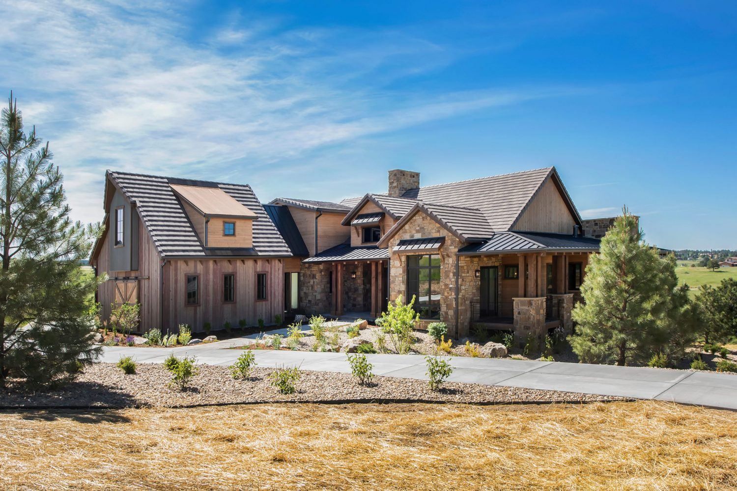 mountain modern home in Colorado designed by Godden Sudik architects with reclaimed wood siding