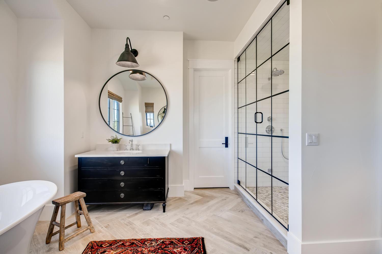modern farmhouse bathroom in custom home built in Colorado