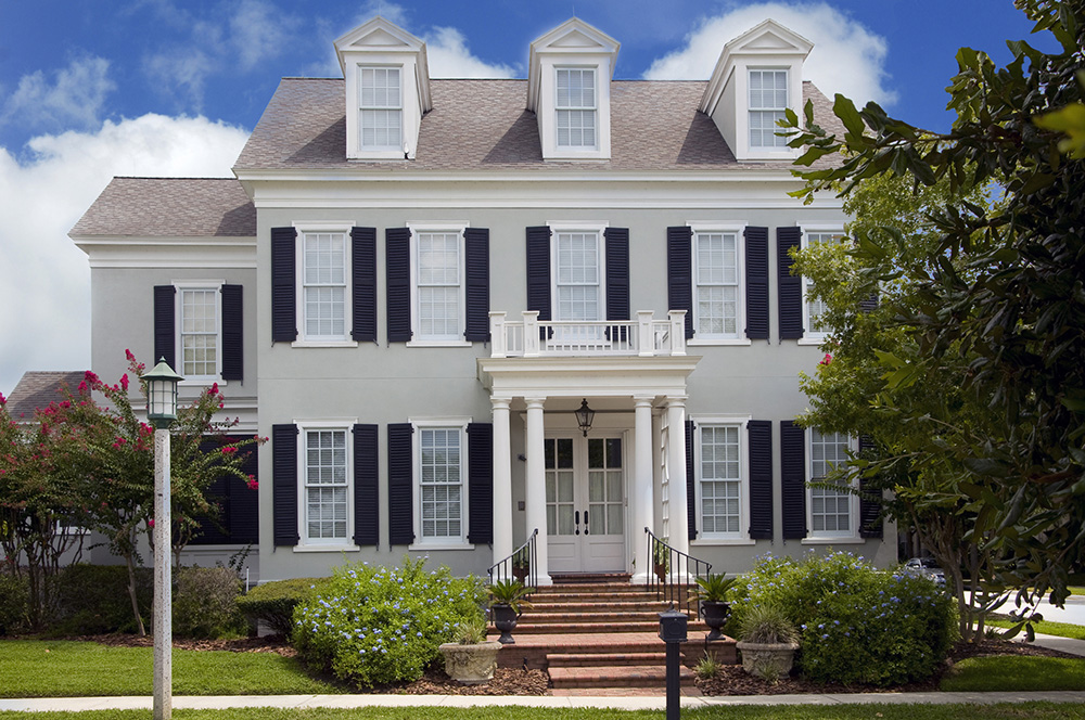 Two story colonial style home with shutters