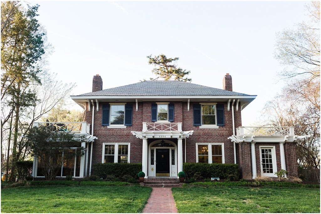 A Colonial revival style home made of red brick