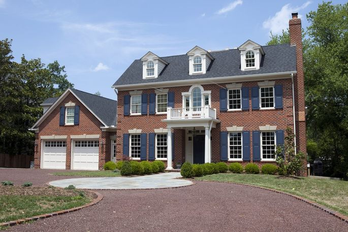 A Two story colonial revival house made from brick