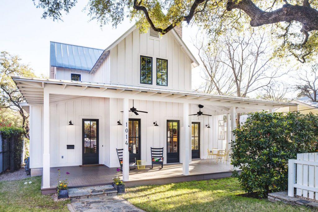 A two story wooden batten modern farmhouse