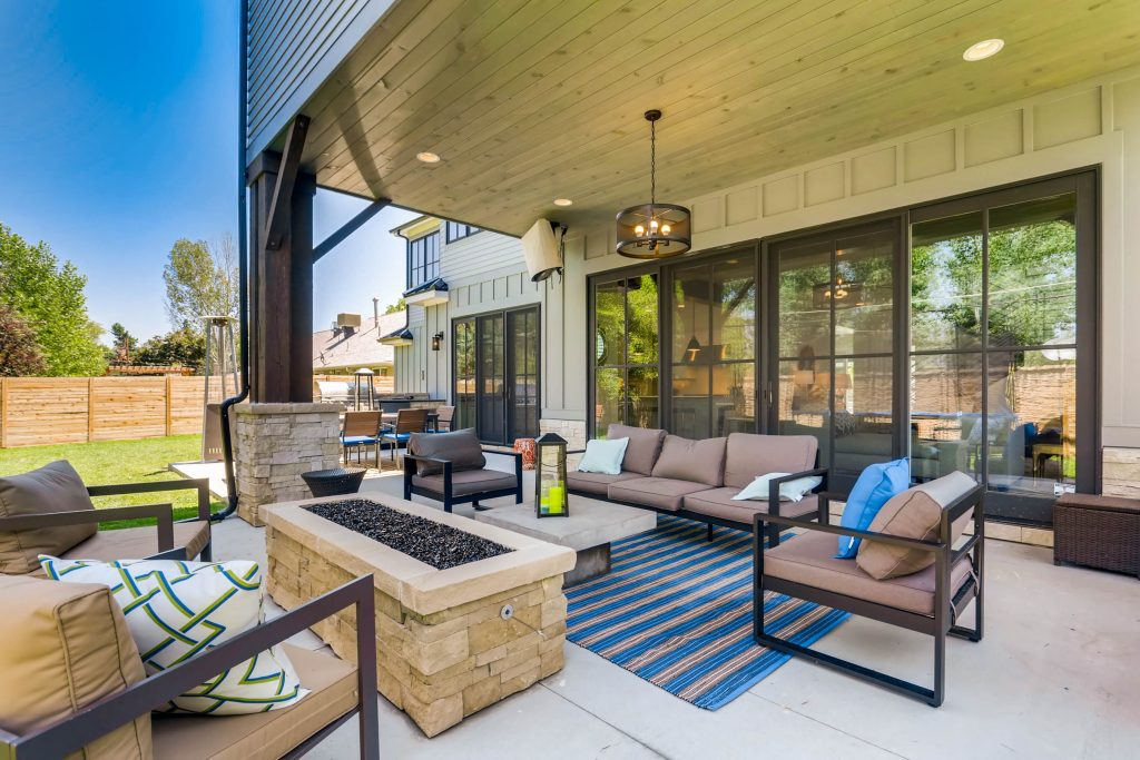 outdoor patio, with couches and stone fireplace