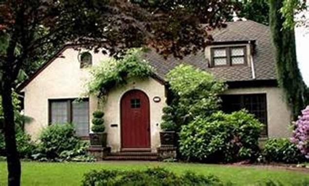 stucco and shingle roof english cottage style home