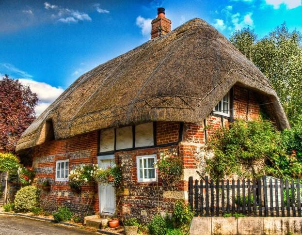 straw roof and stone english cottage with wood elements